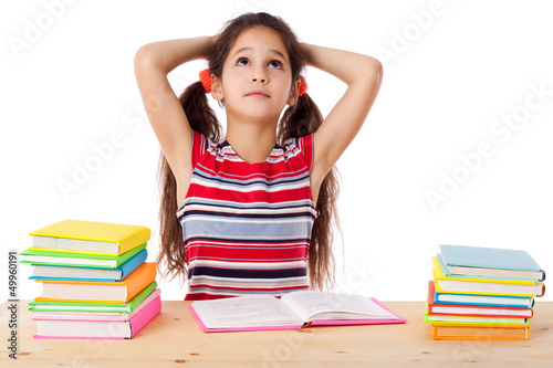 Tired girl with stack of books