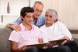 Family looking through photo album