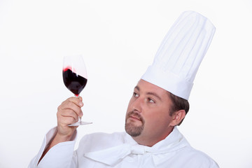 Chef with a glass of red wine
