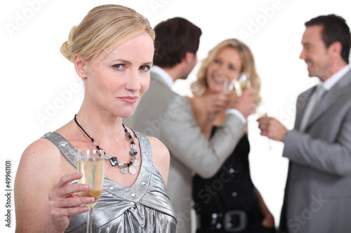 Blond woman holding up champagne