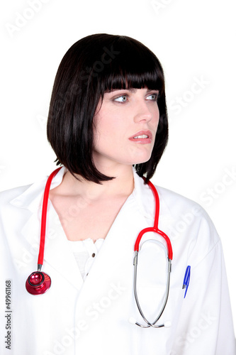 A doctor glancing sideways