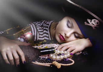 Woman pirate sleeping  with a bottle