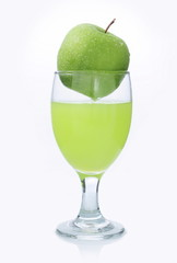 glass of apple juice and apple green in it, isolated