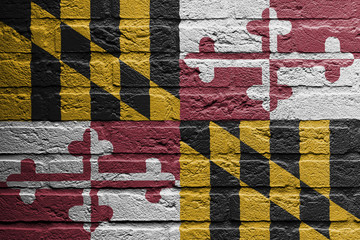 Brick wall with a painting of a flag, Maryland