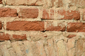 ancient brick wall repair background closeup