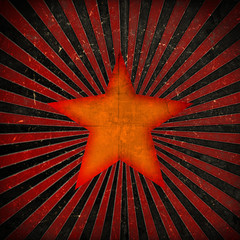 Orange star on grunge background