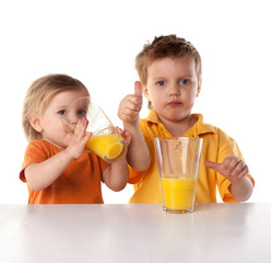happy children drink orange juice isolated on white