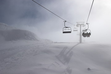 Ski chairlift on foggy day