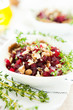 slices of beet with crushed nuts, salad
