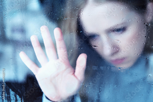 melancholy and sad girl   at the window in the rain - 49968776