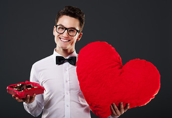 Man holding heart shape and box of chocolate