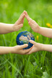 Planet Earth in children`s hands