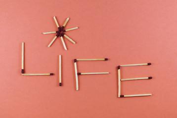 Word Life made of matchsticks