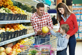 Fototapety Family with child shopping fruits