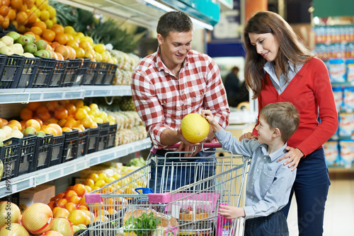 Family with child shopping fruits