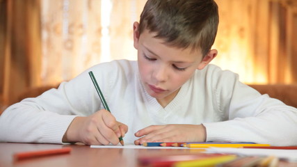 Child doing homework at home