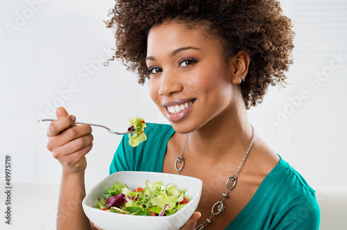 African American Woman Eating Salad