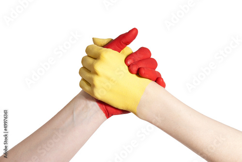 red and yellow hand in competition