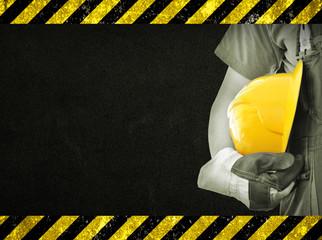 Worker and dark texture in background