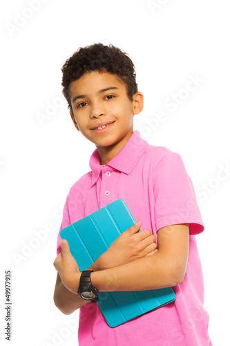 Happy black boy with tablet computer