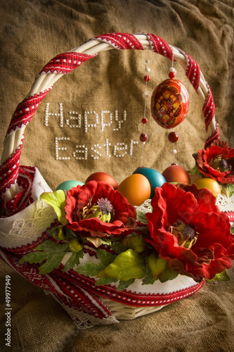 Basket with eggs and greeting 'Happy Easter'