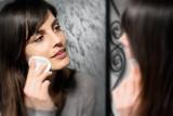 brunette girl cleansing her face poster