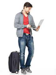 Full portrait of man with suitcase and laptop