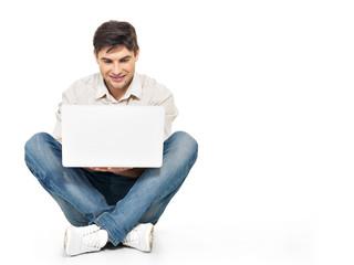 Portrait of  happy man working on laptop