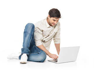 Portrait of  happy man working on laptop