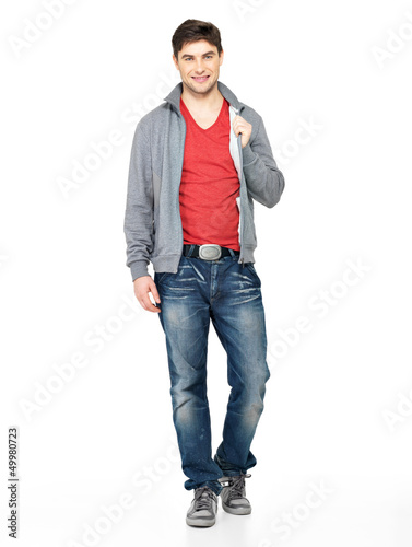 happy handsome man in grey jacket, blue jeans