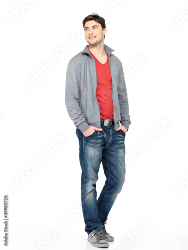 happy handsome man in grey jacket and blue jeans