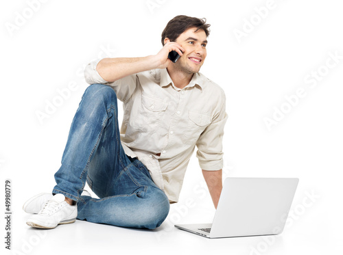 man calling by mobile with laptop