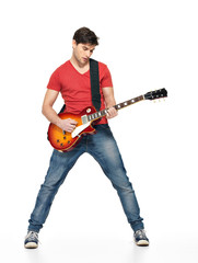 Guitarist man plays on the electric guitar