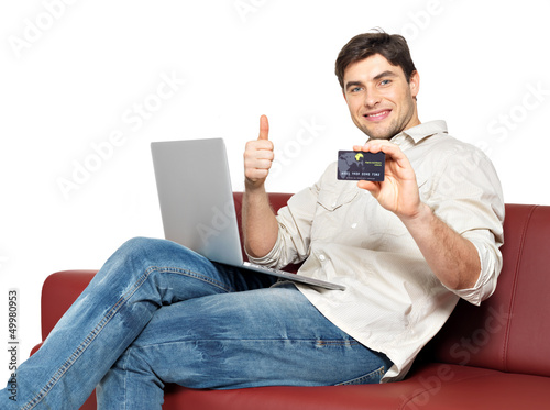 man with laptop shows the credit card