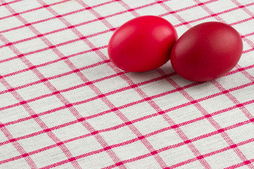 easter eggs an red checked textile
