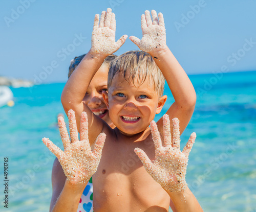 Girl and boy On Sand
