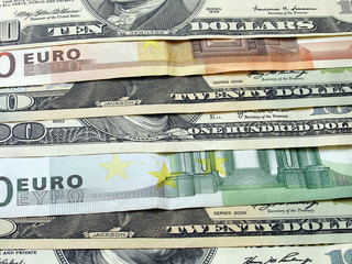 close up of euro and dollars