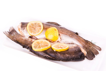 Trout with lemon cooked in a steamer. Healthy food concept.