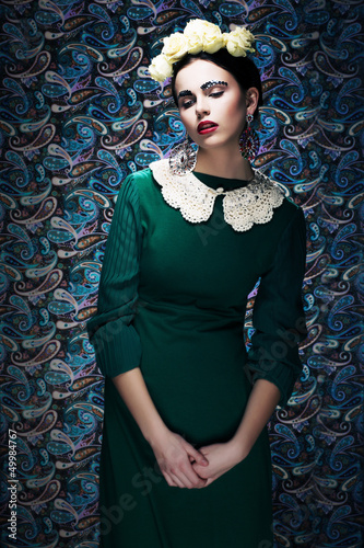 Romantic Young Styled Woman in Green Vintage Dress. Pin-up