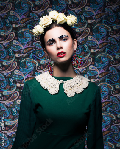 Elegant Lady in Green Dress and Roses. Retro Style