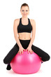 Young woman doing fitness exercises with gym ball isolated