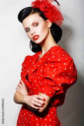 Arrogant Woman in Red Polka Dot Dress, Crossed Arms. Pin Up