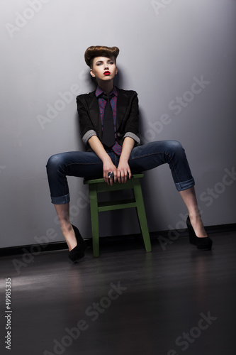 Atrractive Fashionable Brunette sitting. Elegance