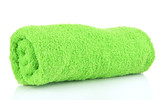 Rolled up green towel isolated on white