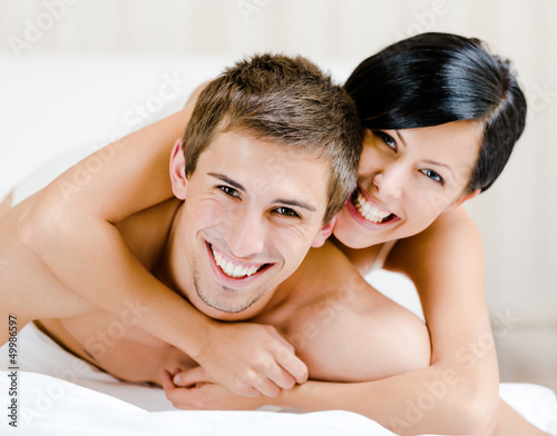 Close up of laughing couple who plays in bed