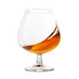 Cognac splashes in a glass