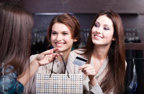 Pretty women pay with credit card