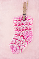 Baby girl socks on pink background
