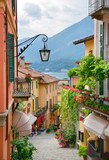 Fototapeta Picturesque small town street view in Lake Como Italy