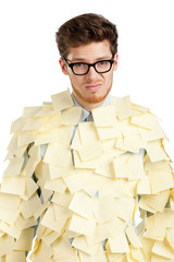 Sad young man with a glasses covered with yellow stickers